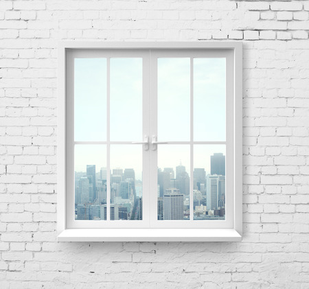 Modern window with skyscraper view in brick wall photo