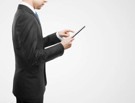 businessman holding digital tablet, closeup photo