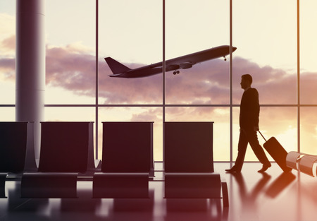 businessman walking in airport  and airplane in sky photo