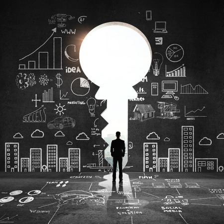 education technology: businessman looking an big key and drawing concept