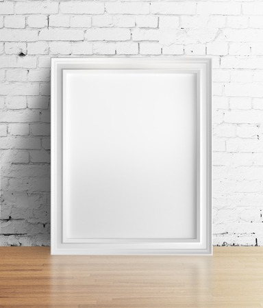amaged: blank frame standing in brick room