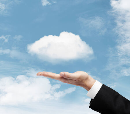 singn: hand with cloud on sky background