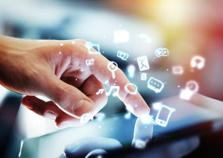 hand touching digital tablet, social media concept Standard-Bild