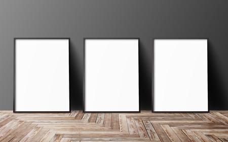 tres carteles en blanco que cuelga en la pared