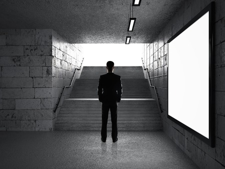 businessman standing in underground passage and looking at ladder Stock Photo - 30002355
