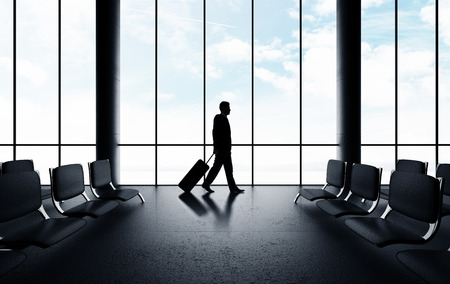 businessman walking in airport with luggage Stock Photo - 30002358