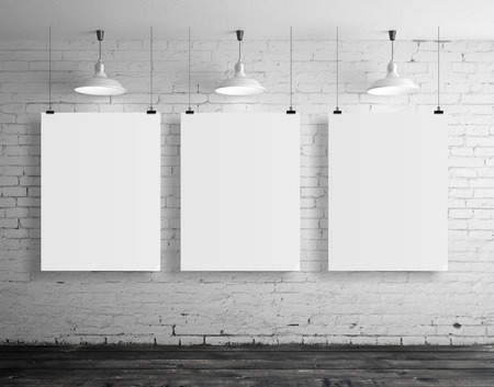 three blank frame in brick loft room