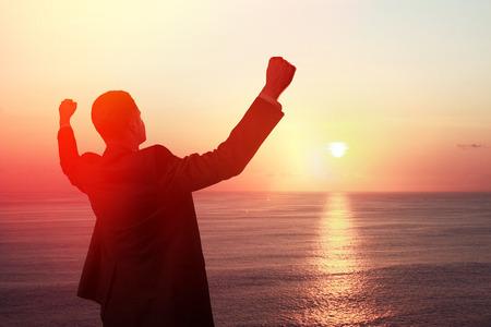 happy businessman looking at sunrise Stock Photo - 30002546