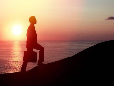 businessman walking on rock and sunrise photo