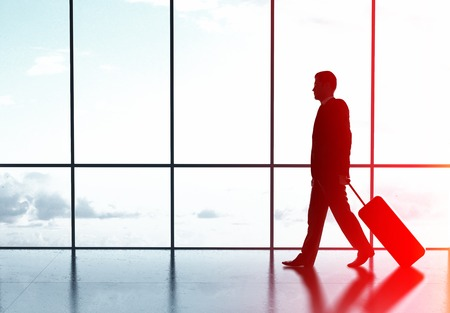 vanish: businessman walking in airport with luggage Stock Photo