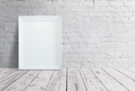 blank frame hanging on brick wall