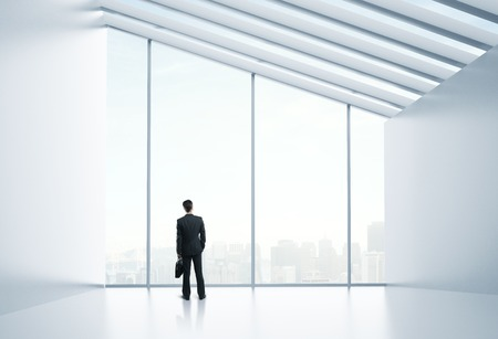 businessman standing and thinking in office photo