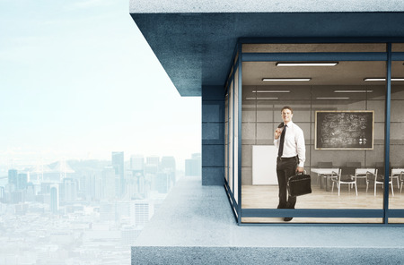 man in suit standing in loft house photo