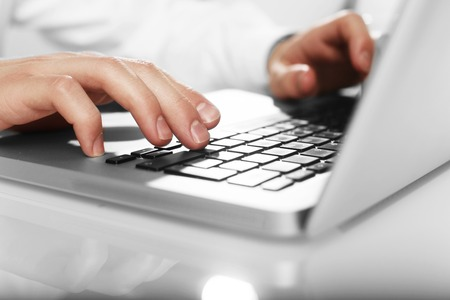 businessman working on laptop, close up photo