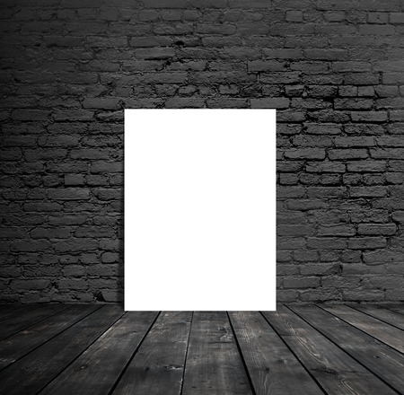 amaged: blank paper hanging on a brick wall Stock Photo