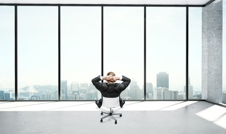 young businessman sitting in office and thinking photo