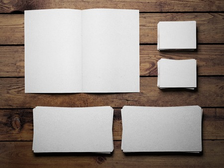 Open white book on a wooden table photo