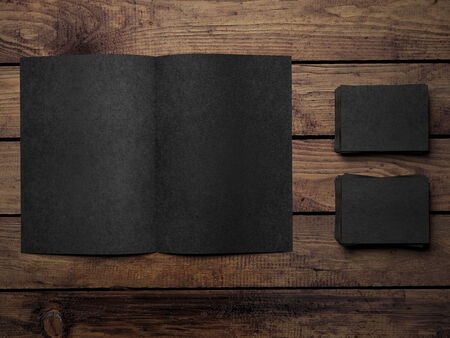 Open black book on a wooden table photo