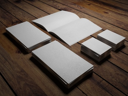 Open white book and paper cards on a wooden table photo