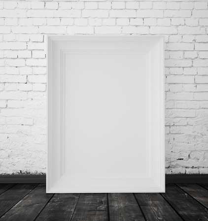 amaged: blank paper hanging on a white brick wall