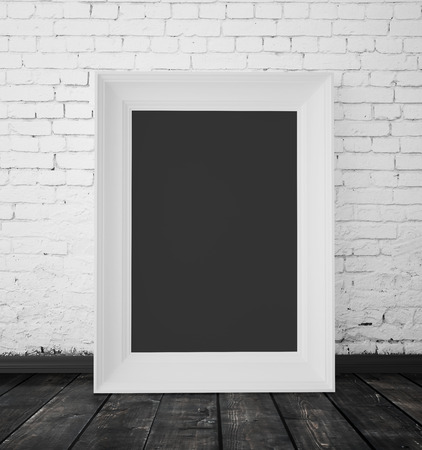 amaged: blank frame hanging on a brick wall
