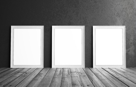 amaged: three white frame hanging on a wall