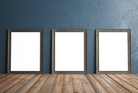 amaged: three white frames hanging on a blue wall