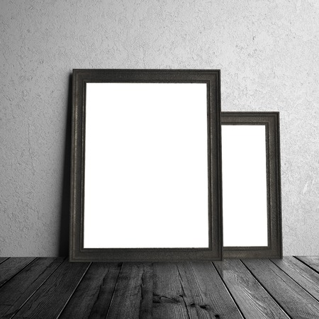 amaged: two white frames hanging on a wall