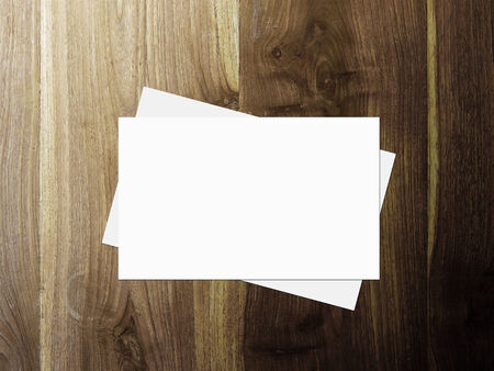 visiting card design: stack of business cards on wooden table