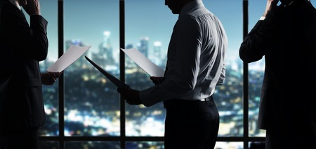 businessman with paper working in night office