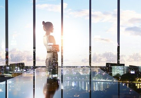 house windows: businesswoman thinking in office and looking to city