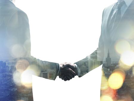 persone nere: handshake on a modern building background