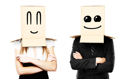 businessman and woman with smiling box on head Stock Photo