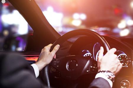driving car: businessman driving a car at night