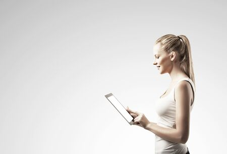 touch pad: woman with  touch pad on gray background Stock Photo