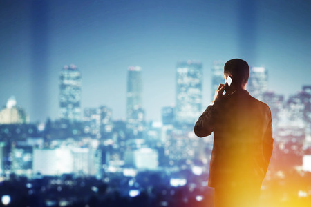 businessman with cellphone  looking to modern city