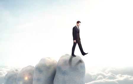 abyss: businessman falls into the abyss on sky background