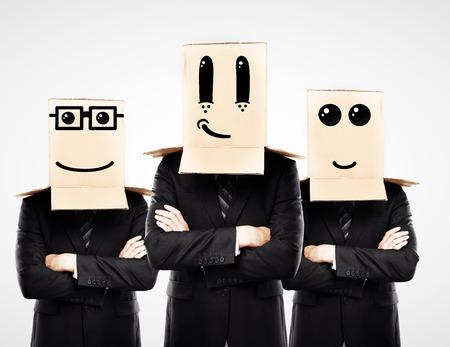 cowardice: three man with happy box on hand