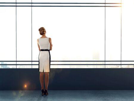 modern office: businesswoman in modern office looking to sky