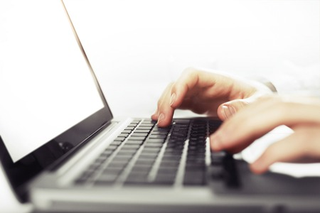 internet keyboard: businessman hands working on laptop, close up Stock Photo