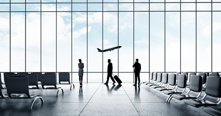 airports: airport with people and airliner in sky Stock Photo