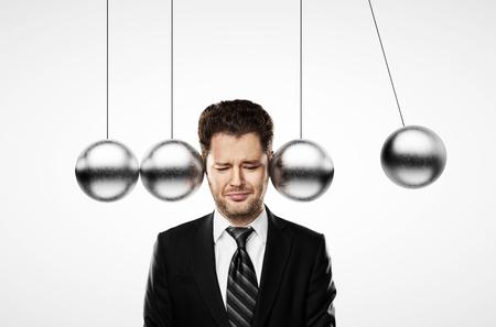 pendulum: businessman thinking and head metal pendulum Stock Photo