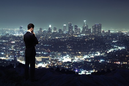 businessman looking to night city Stock Photo