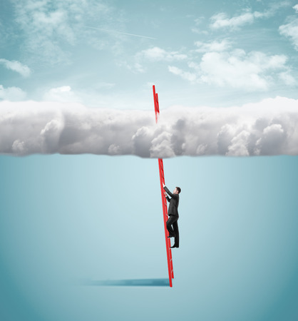 ladder: young businessman climbing on ladder to clouds Stock Photo