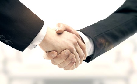 handshake on a city background. Stock Photo
