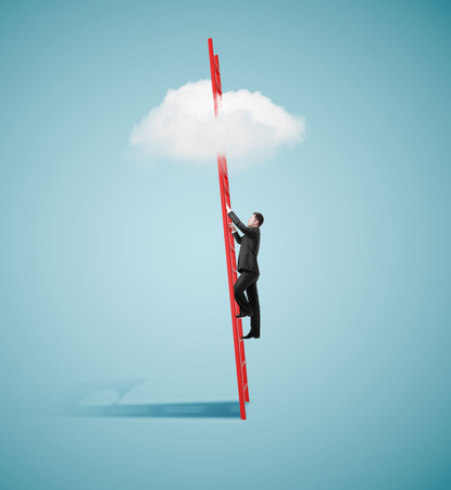 cloud background: businessman climbing on ladder to clouds