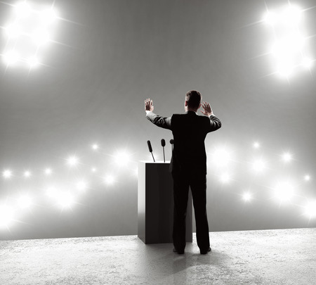 outbreaks: businessman standing on podium and closes on outbreaks