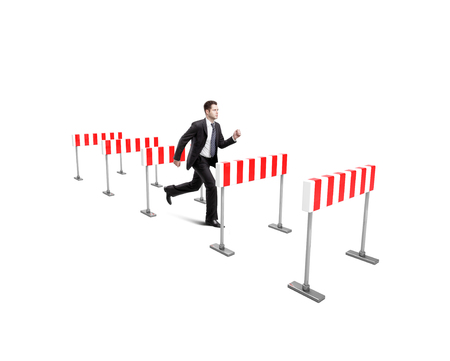 different goals: businessman jumping over barrier  on a white background