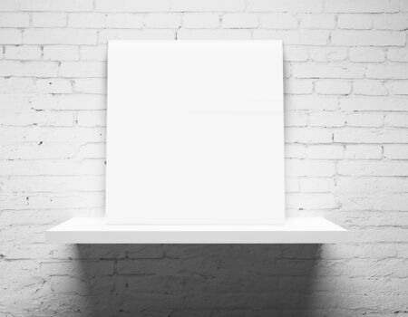 white shelf: brick wall and white shelf with poster Stock Photo