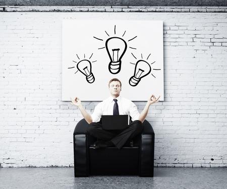 man meditating: man meditating in brick room, idea concept